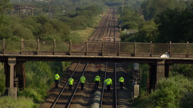 police search rail tracks where two rail workers have died after being hit by a passenger train just outside of port talbot wales - railway track stock videos & royalty-free footage