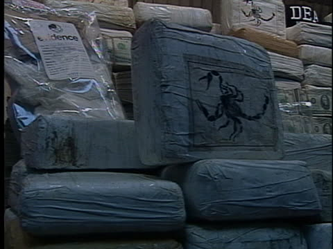 police seized two million dollars in cash and thirty million dollars' worth of cocaine in operation green ice busts against members of the cali... - bag stock videos & royalty-free footage