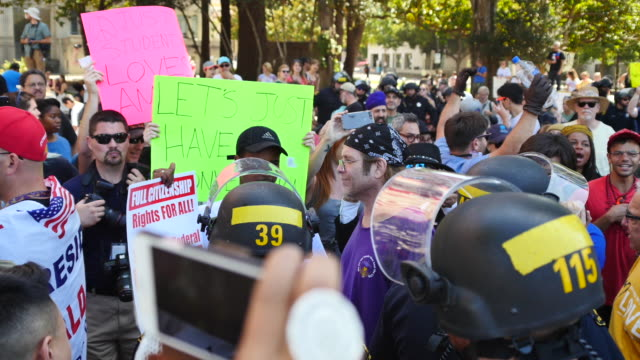 Police separate Trump supporters and counter demonstrators who had been arguing and scuffling in Martin Luther King Park in Berkeley California...