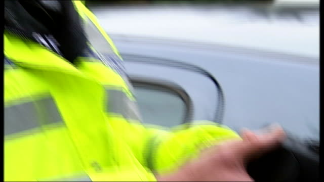 police set up scheme to fingerprint drivers england ext line of police cars at roadside with police officers standing on verge police officer as... - fingerprint stock videos & royalty-free footage