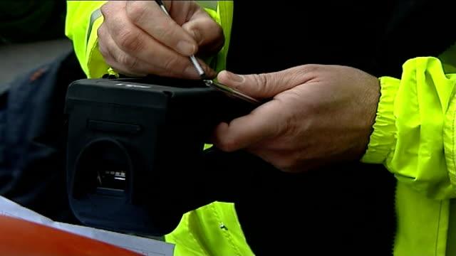 police set up scheme to fingerprint drivers luton ext police officer using fingerprint scanner police officer talking to man whose fingerprints he... - roadside stock videos & royalty-free footage