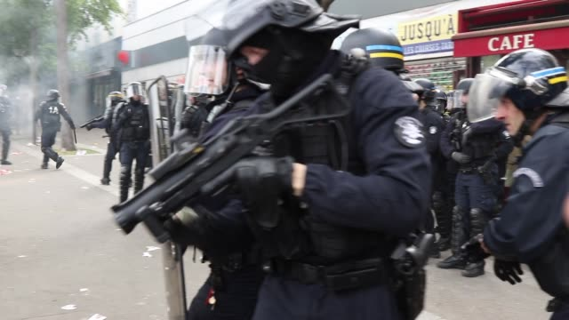police shoot with a flash ball. the annual may day protests on may 01, 2019 at boulevard de l'hopital, paris, france. more than 7,400 police and... - may day international workers day stock videos & royalty-free footage