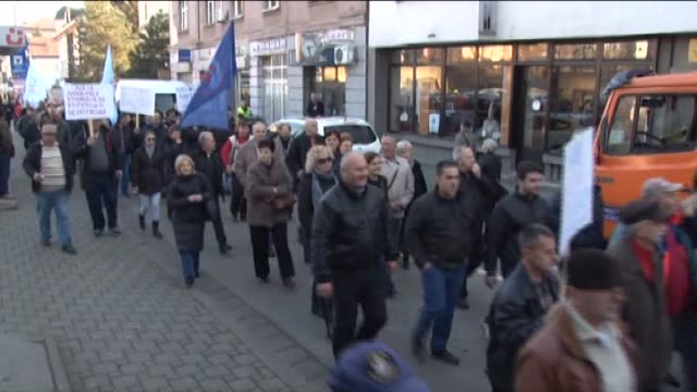 police stand guard as demonstrators stage a protest against the new labour law in front of the assembly in banja luka, republika srpska on december... - banja luka stock videos & royalty-free footage