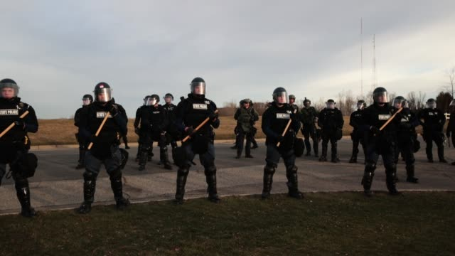 police stand guard as white nationalists clash with counterdemonstrators before the start of a speech by white nationalist richard spencer who... - lansing stock videos and b-roll footage