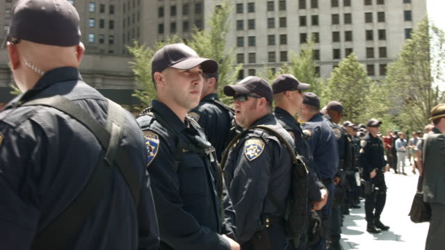 police stand guard during protests near the site of the republican national convention in downtown cleveland on the second day of the convention on... - republikanischer parteitag stock-videos und b-roll-filmmaterial
