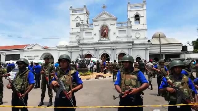 police stand guard outside st. anthony's shrine in sri lanka's capital colombo and a bomb disposal unit is on site as the death toll in a string of... - sri lanka stock videos & royalty-free footage