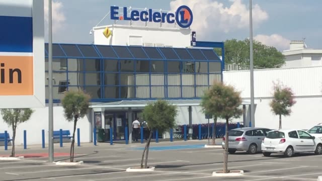 Police stand on site at the scene where two people were injured at a supermarket in the southern French town of Seyne sur Mer when a woman shouting...