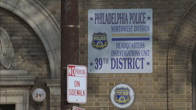a police station stands in philadelphia. - politik und regierung stock-videos und b-roll-filmmaterial