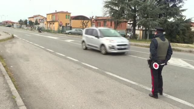 police stop and check cars going through the extended lockdown area in valsamoggia in northern italy - kontrolle stock-videos und b-roll-filmmaterial