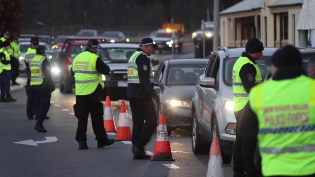 police stop and question drivers at a checkpoint on july 8, 2020 in albury, australia. the nsw-victoria border closed at midnight, wednesday 8 july.... - customs stock videos & royalty-free footage