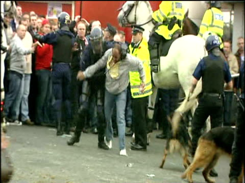 police struggle with football fan pulling him to ground during violent disturbances at old trafford football ground prior to manchester united vs... - hooligan stock videos & royalty-free footage