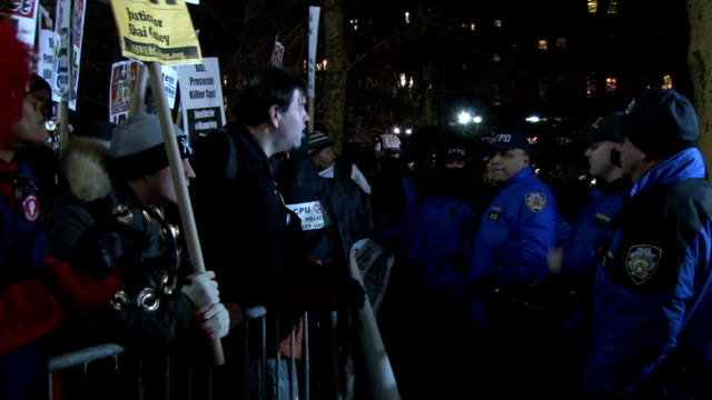 Police supporters at a proNYPD rally in City Hall Park Manhattan clash with antipolice/antipolice brutality protesters over the recent killings of...