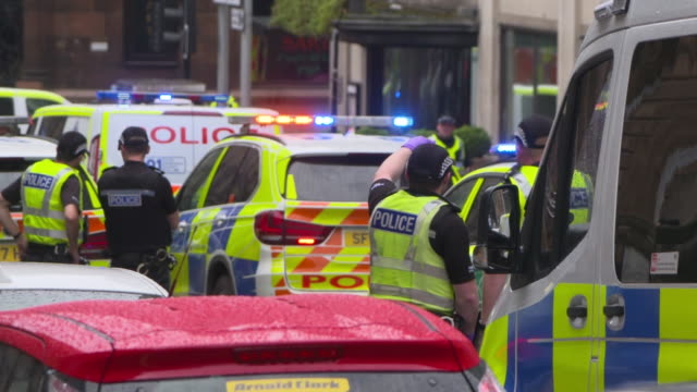 """police surrounding the park inn hotel in glasgow after a knife attack - """"bbc news"""" stock videos & royalty-free footage"""