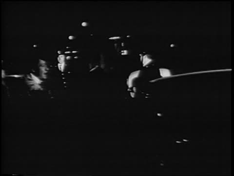 b/w 1967 police surrounding young man at antiwar demonstration at night / rome italy / newsreel - festnahme stock-videos und b-roll-filmmaterial