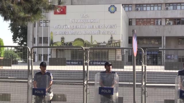 police take security measures around the diyarbakir municipality building after mayor of diyarbakir adnan selcuk mizrakli was suspended for... - mayor stock videos and b-roll footage