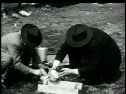 1948 montage police taking plaster of paris cast of footprint / new york city, new york, united states - plaster stock videos and b-roll footage