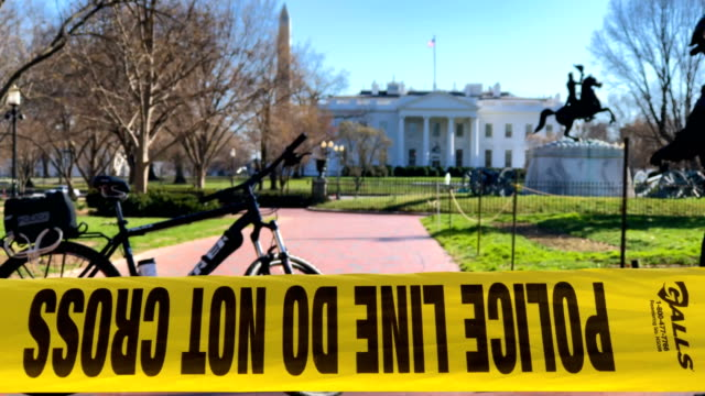 Police tape is seen after members of the US Secret Service Uniform Division sealed off Lafayette Square in front of the White House for the arrival...