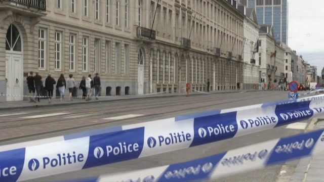 police tape outside of a city street in brussels belgium - human rights or social issues or immigration or employment and labor or protest or riot or lgbtqi rights or women's rights stock videos & royalty-free footage
