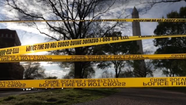 police tapes blocks off a pathway at the national mall near the washington monument during the coronavirus pandemic on april 3, 2020 in washington,... - maryland stato video stock e b–roll