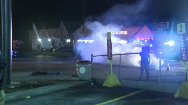 police throw tear gas at protesters after they are hit by molotov cocktails and looting breaks out in ferguson - missouri stock videos & royalty-free footage