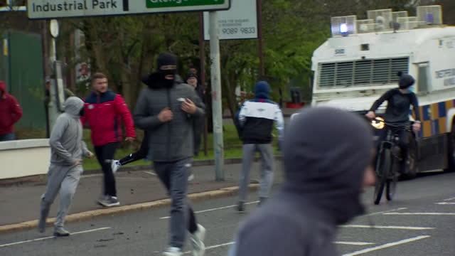 police try to push back youth rioters in belfast as tensions rise between loyalists and nationalists - adolescence stock videos & royalty-free footage