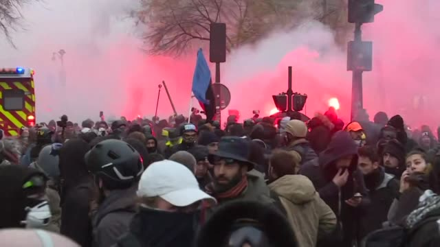 police use tear gas to disperse rioters during a demonstration against pension reform in paris - pension stock videos & royalty-free footage