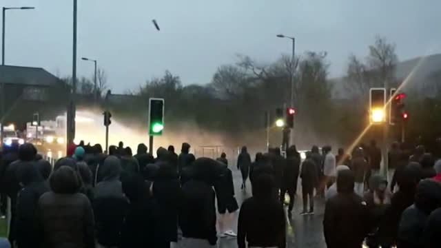 police use water canons to control rioters on the nationalist side of the peace line in belfast - side view stock videos & royalty-free footage