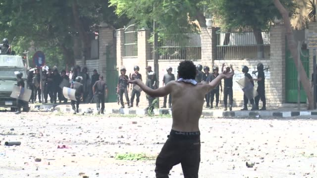 police used tear gas as they clashed on thursday with a stone and bottlethrowing crowd protesting outside the us embassy in cairo at a film mocking... - demonstration stock videos & royalty-free footage