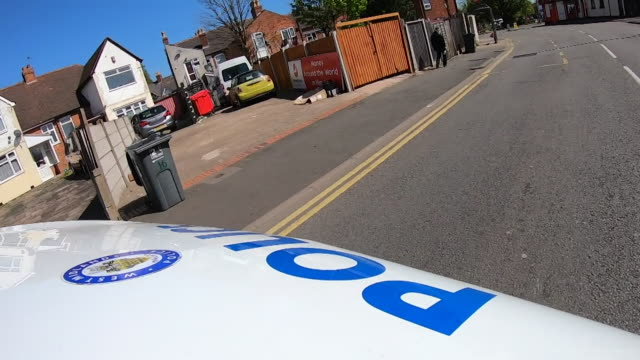 pov of police van driving down road - uk video stock e b–roll