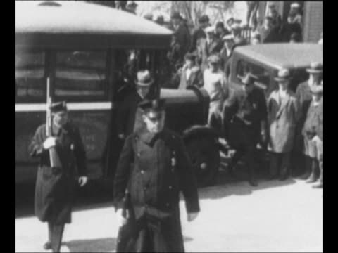 police van pulls to curb and police armed with rifles decar other men decar nicola sacco and bartolomeo vanzetti decar handcuffed to each other and... - passing a note stock videos and b-roll footage