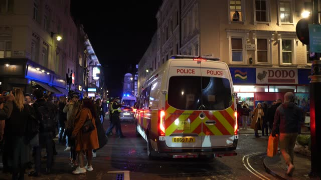 police van turns up to help disperse crowds on november 4, 2020 in london, england. non-essential businesses, including pubs and restaurants, will be... - turning stock videos & royalty-free footage
