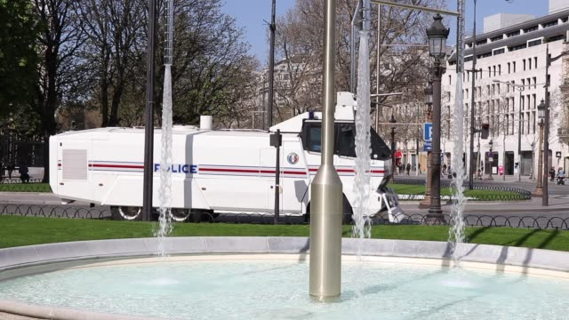 police vehicle with a water cannon parked on the roundabout champs elysées - water cannon stock videos & royalty-free footage