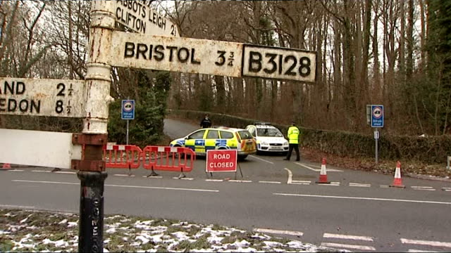 police vehicles parked in lane and forensics tent covering site where body of joanna yeates was found just visible various of police vehicles and... - clifton suspension bridge stock videos and b-roll footage