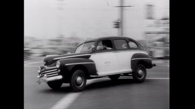 1952 police vehicles speed through the streets of kansas city - 1952 stock videos & royalty-free footage