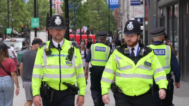 police walk along a busy oxford street following closure due to the coronavirus outbreak on june 15, 2020 in london, united kingdom. the british... - rescue worker stock videos & royalty-free footage