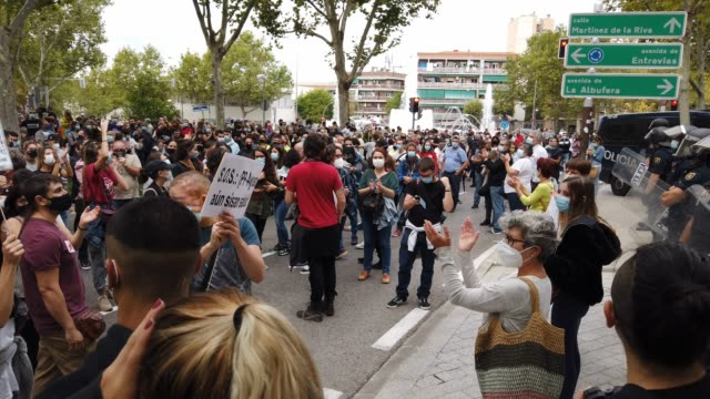police watch over protestors chanting, clapping and holding signs in the streets during a demonstration, in the vallecas neighborhood, against the... - number 2 stock videos & royalty-free footage