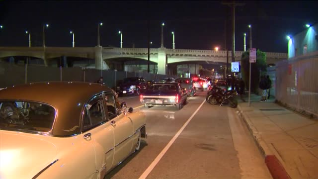 KTLA Police were called in when hundreds of people and cars began to gather on the iconic Sixth Street Bridge in downtown Los Angeles on the eve of...