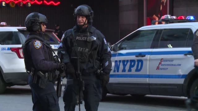 police were on site as people stopped to look and film the scene at port authority bus terminal after an explosion - port authority stock videos & royalty-free footage