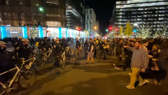 "police with bicycles move back protesters after a clash following the ""million maga march"" on november 14, 2020 in washington, dc. various pro-trump... - confrontation stock videos & royalty-free footage"