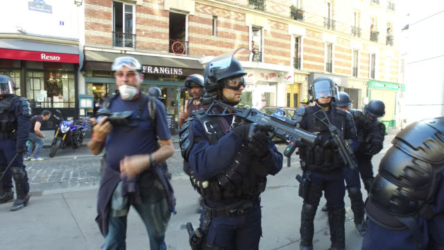 police with defense ball launcher - french culture stock videos & royalty-free footage