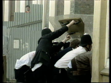 police with riots shields in rubble strewn street brixton riots; apr 81 - 1981 stock videos & royalty-free footage