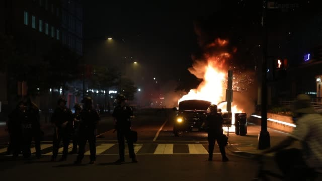 police work to keep demonstrators back as cars are on fire during a protest near lafayette square park on may 30 2020 in washington dc across the... - lafayette square washington dc stock videos & royalty-free footage