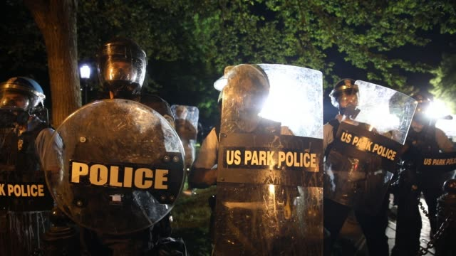 police work to keep demonstrators back during a protest in lafayette square park on may 30 2020 in washington dc across the country protests were set... - lafayette square washington dc stock videos & royalty-free footage