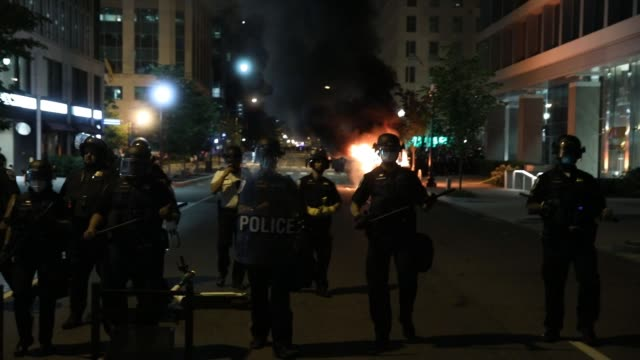 police work to keep demonstrators back during a protest near lafayette square park on may 30 2020 in washington dc across the country protests were... - lafayette square washington dc stock videos & royalty-free footage