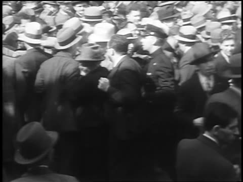 B/W 1933 policeman amongst shoving crowd at Communist demonstraton / Union Square NYC