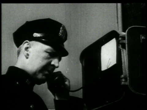 1948 montage policeman calls in report of crime / brooklyn, new york, united states - detektiv stock-videos und b-roll-filmmaterial
