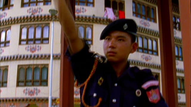policeman directs traffic from gazebo in centre of road available in hd. - gazebo stock videos and b-roll footage