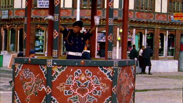 policeman directs traffic while standing in gazebo available in hd. - gazebo stock videos and b-roll footage