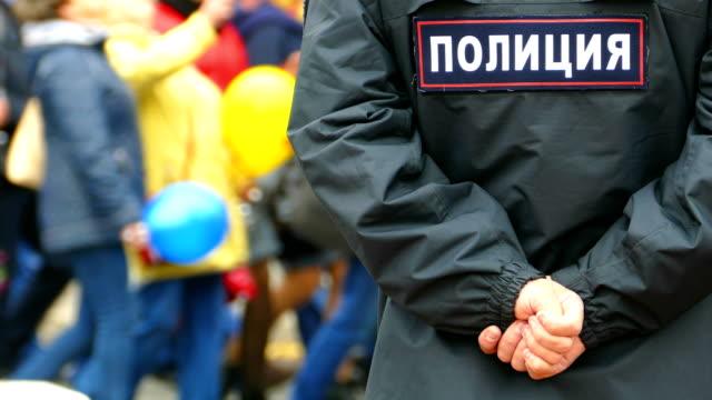 policeman ensures order at the demonstration - terrorism stock videos & royalty-free footage