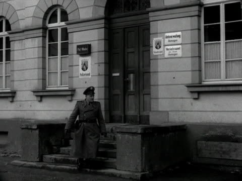 a policeman leaves a police station in remagen and walks down a narrow street 1955 - narrow stock videos & royalty-free footage